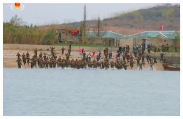 KPA service members wade into the water as Kim Jong Un departs Mahap Islet (Photo: Korean Central Television).