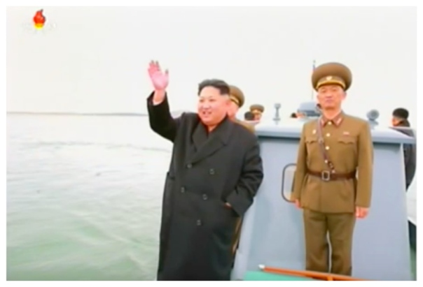Kim Jong Un waves to KPA service members while department Mahap Islet. Also in attendance, right is IV Army Corps Commander Lt. Gen. Ri So'ng-kuk (Photo: Korean Central Television).