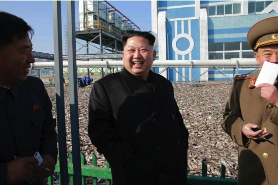 Kim Jong Un smiles during a visit to the May 27 Fishery Station of the KPA.  Also in attendance, right, is 1st Vice Minister of the People's Armed Forces Col. Gen. So Hong Chan (Photo: Rodong Sinmun).