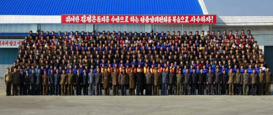 Commemorative photo of Kim Jong Un with managers and employees of the January 8 Fishery Station which appeared in the center of page 4 of the November 17, 2016 edition of Rodong Sinmun (Photo: Rodong Sinmun).