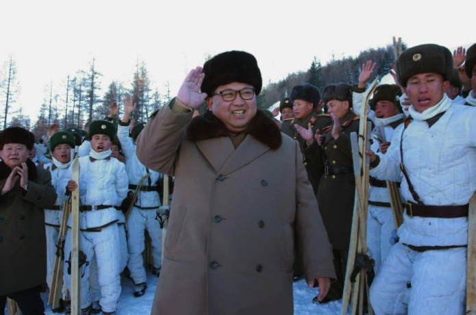 Kim Jong Un greets members of a mountain warfare infantry element subordinate to KPA Unit #1045 in a photo which appeared top-center on the front page of the November 26, 2016 edition of the WPK daily newspaper Rodong Sinmun.  Also in attendance, background L, is WPK Vice Chairman and SAC Vice Chairman Choe Ryong Hae (Photo: Rodong Sinmun).