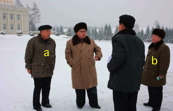 Kim Jong Un visits the area near the KJI statue in Samjiyo'n County, Yanggang Province.  Also in attendance are Yanggang WPK Provincial Committee Chairman Ri Sang-wo'n [a] and WPK Vice Chairman and SAC Vice Chairman Ch'oe Ryong-hae [b] (Photo: Rodong Sinmun).