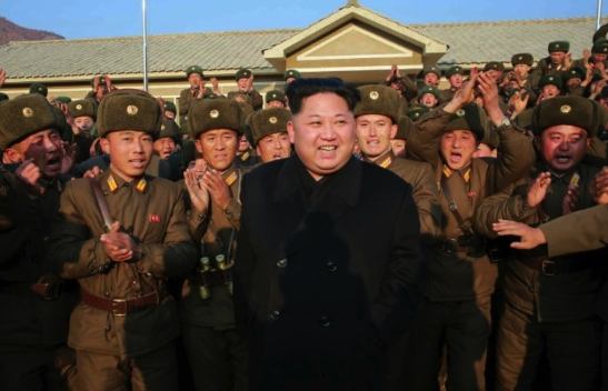Kim Jong Un smiles whilst greeting KPA service members and officers of a sub-unit subordinate to KPA Unit #1344 in a photo which appeared top-center of the November 9, 2016 edition of the WPK daily newspaper Rodong Sinmun (Photo: Rodong Sinmun).