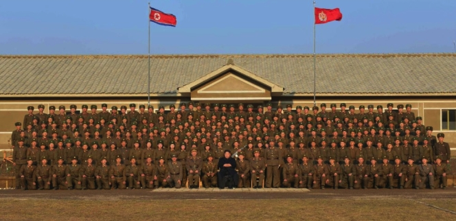 Commemorative photograph of Kim Jong Un and members of the sub-unit subordinate to KPA Unit #1344 which appeared on the front page of the November 9, 2016 edition of the WPK daily organ Rodong Sinmun (Photo: Rodong Sinmun).