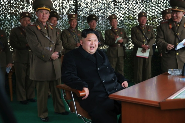 Kim Jong Un grins whilst watching a women gunners' MLRS firing contest in a photo which appeared top-center of the front page of the November 19, 2016 edition of the WPK daily organ Rodong Sinmun. Also in attendance is Chief of the KPA General Staff VMar Ri Myong Su (left) and KPA General Staff Operations Bureau Col. Gen. Ri Yong Gil (right) (Photo: Rodong Sinmun).