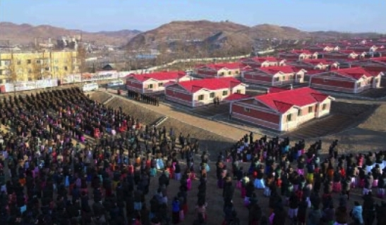 View of a rally opening apartment housing as part of flood recovery efforts in North Hamgyo'ng Province (Photo: Rodong Sinmun).