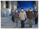 Pak Pong Ju (center in black hate and grey parka) tours the Komdok Mining Industry Complex with senior party and government officials (Photo: KCNA).