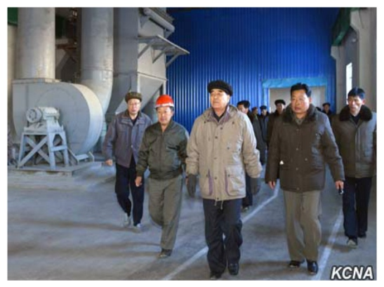 Pak Pong Ju (center in black hat and grey parka) tours the Komdok Mining Industry Complex with senior party and government officials (Photo: KCNA).