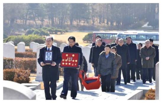 Ryu Mi Yong's casket is brought to her family grave (Photo: KCNA).