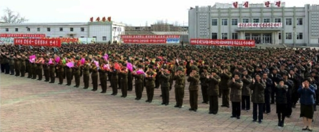 View of participants at a November 23, 2016 army-party solidarity rally in Kangryo'ng County, South Hwanghae, marking the 6th anniversary of the artillery shelling of Yo'npyo'ng Island ROK which appeared on the bottom right of the front page of the November 24, 2016 edition of the WPK daily newspaper Rodong Sinmun (Photo: Rodong Sinmun).