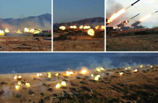 Views of a live fire artillery exercises by artillery units under the KPA Southwest Command (Photos: Rodong Sinmun/KCNA).