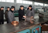 Pak Pong Ju touring the Kim Jong Thae Locomotive Complex on December 22. Photo: KCNA/Rodong Sinmun