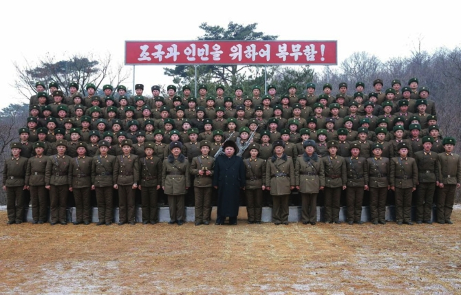 Commemorative photo of Kim Jong Un with officers and service members of a company subordinate to KPA Unit #233 which appeared top-center on the front page of the January 19, 2017 edition of the WPK daily newspaper Rodong Sinmun (Photo: Rodong Sinmun/KCNA).