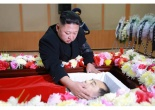 Kim Jong Un touches the face of the remains of Kang Ki Sop, head of North Korea's civil aviation administration and alternate member of the WPK Central Committee, at Kang's wake in Pyongyang January 22, 2017 (Photo: Rodong Sinmun/KCNA).