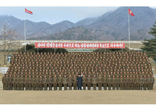 Commemorative photo of Kim Jong Un with officers and service members of KPA Unit #1314 (Photo: Rodong Sinmun/KCNA).