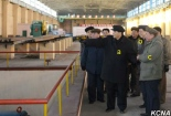 Pak Pong Ju [a], DPRK Vice Premier and State Planning Commission Chairman Ro Tu Chol [b] and Hwanghae Iron and Steel Complex chief Kim Chung Gol [c] Pak Pong Ju's touring the Hwanghae Iron and Steel Complex.
