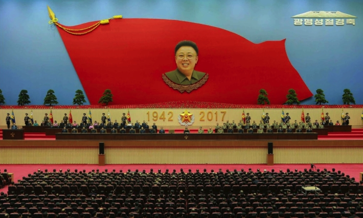 View of the platform and venue for a February 15, 2016 central report meeting marking late DPRK leader Kim Jong Il's birth anniversary (Photo: Rodong Sinmun).
