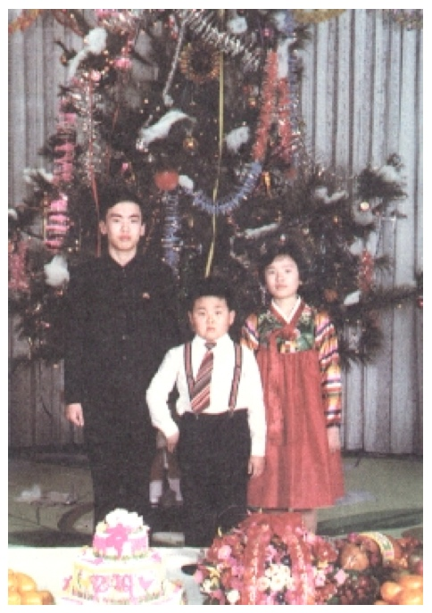 Kim Jong Nam brandishing a gold pistol, with his maternal cousins, at a party celebrating Kim Jong Il's birthday in 1979