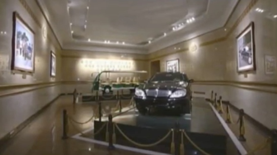 View of a room displaying Kim Jong Il's personal car and his electric mobility cart at Ku'msusan Palace of the Sun in Pyongyang (Photo: Korean Central Television).