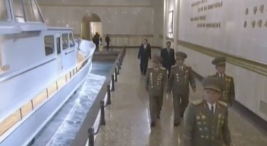 Senior KPA command staff and WPK cadres file past a display of Kim Jong Il's personal boat on February 16, 2017 at the Ku'msusan Palace of the Sun in Pyongyang (Photo: Korean Central Television).