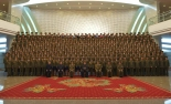 Kim Jong Un, senior DPRK officials and members of the State Merited Chorus (Merited State Choir) pose for commemorative photograph in the lobby of the People's Theater in Pyongyang on February 22, 2017 in a photo which appeared top-center of the front page of February 23, 2017 edition of the WPK daily organ Rodong Sinmun.