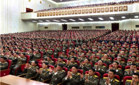 Participants applaud during a February 7, 2017 meeting marking the KPA's historical anniversary. This photo appeared bottom-right on the front page of the February 8, 2017 edition of the WPK daily organ Rodong Sinmun (Photo: Rodong Sinmun/KCNA).