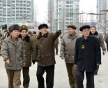 Pak Pong Ju (middle) touring the Ryomyong Street with Minister of Chemical Industry Ri Mu Yong. Photo: KCNA