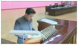 Jon Kwang Ho gives a report at a land and environment meeting held at the People's Palace of Culture. (Photo: KCNA)