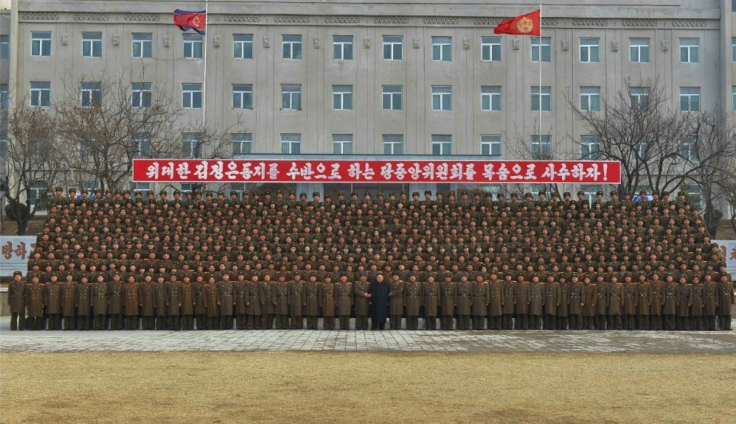 Kim Jong Un poses for a commemorative photo with command staff, service members and officers of KPA Large Combined Unit #966 in a photo which appeared on top-center of the front page of the March 1, 2017 edition of the WPK daily organ Rodong Sinmun